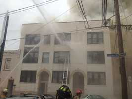 Firefighters battled the five-alarm blaze on Zulema Street, between Ward and Bates streets.