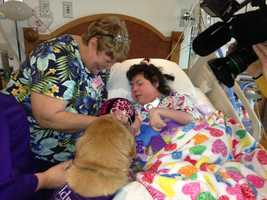 Susan Sacco and her daughter, Hope, who has multiple disabilities, love their hospital visits with dogs. Here, they are meeting Joan Stein's pet, Shayna.