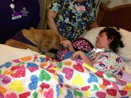 Shayna gave kisses to Hope. The dog is a part of the Pet Friend Visitation Program, which was founded 22 years ago by Dr. Kathy Dougherty, a veterinarian.