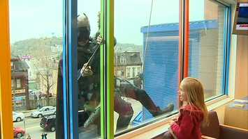 Batman washes the windows at Children's Hospital of Pittsburgh of UPMC.