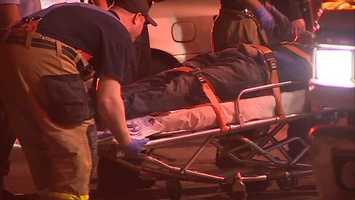 The injured man was taken away in an ambulance.