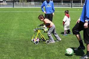 Special needs children were able to get one-on-one instruction from the players on their new field at Station Square.