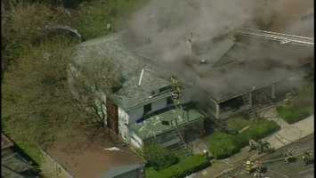 Pittsburgh firefighters battled flames at two houses on Estella Avenue in Mount Washington.