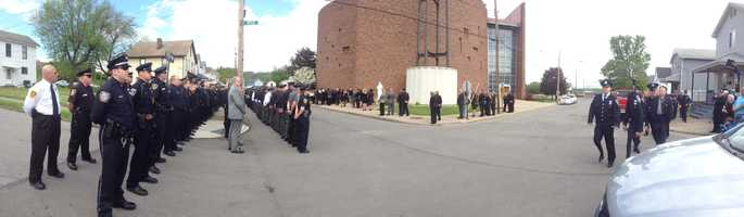 A panoramic shot of the police presence at Jerry McCarthy's funeral.