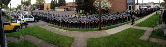 A panoramic photo of a police lineup outside the funeral Mass for Shenango Township Police Officer Jerry McCarthy.