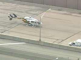 A medical helicopter lands on the Pennsylvania Turnpike in Cranberry Township.