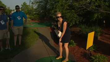 Jackie lines up her putt...