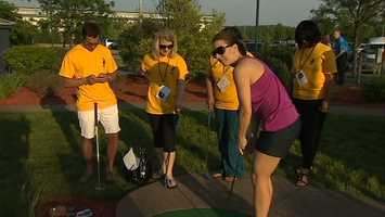 Weather Watch 4 meteorologist Ashley Dougherty stays focused despite a crowd watching on.