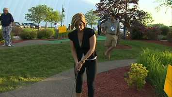 Channel 4 Action News reporter Marcie Cipriani takes a swing.