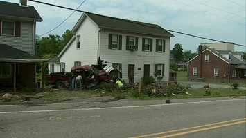 Two people were flown from a violent crash in Forward Township early Sunday morning when a pickup truck sheared a utility pole, slammed into a parked truck and hit the porch of one home before crashing into the house next door.
