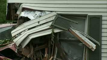 A 62-year-old woman was sleeping in the home next door to Pearson's where the truck crashed through the wall, sending her across the room. The woman's sister said she was shaken up but uninjured and is now staying with relatives.