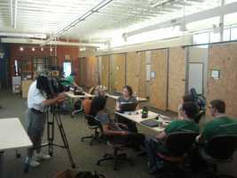 Hahna shows Sally Wiggin how Kickstarter.com works