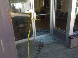 The glass front door of Freestyle Barber Shop was shattered, and one person inside was shot in the arm.