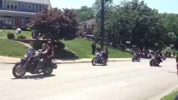 A motorcycle convoy lined the streets outside a Washington funeral home Thursday as riders came to pay respects to one of their fallen brothers.