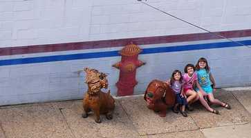 """The art is the work of James Simon, who lives across the street from the shop. """"It's been a really nice thing for the community to put artwork on the streets, so you feel bad when one person disrespects a good thing that's happening,"""" he said."""