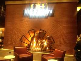 Otis & Henry's Bar & Grill will serve food in a casual setting that includes a brick fireplace.