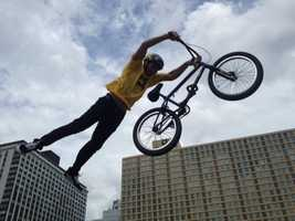 Bike stunts wow the Regatta crowds on the city-side lawn at Point State Park.