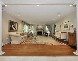 Formal living room features a marble fireplace and is the largest room on the main level.