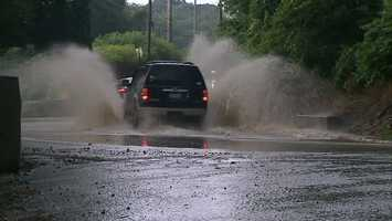 Motorists are warned not to drive through water like this vehicle did on Bethel Church Road in Bethel Park.