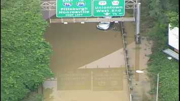 A car got stuck in the flooding on Banksville Road near the ramp to Interstate 376.