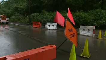 A section of Pitcairn Road is closed after heavy rain caused a mudslide that brought down trees and power lines.