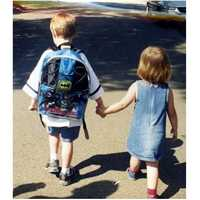 This is Michelle's favorite picture: Her son's first day of kindergarten. When he got off the school bus, his little sister missed him so much that she held his hand all the way home.