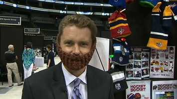 ... and even tries on a playoff beard of his own.