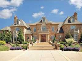 Take a tour of this six bedroom, ten bathroom mansion situated on 22 acres of. The home includes a multi-use stable with indoor riding arena, a beautiful swimming pool and much more. The home is featured on realtor.com