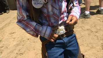 He got his very own belt buckle ...