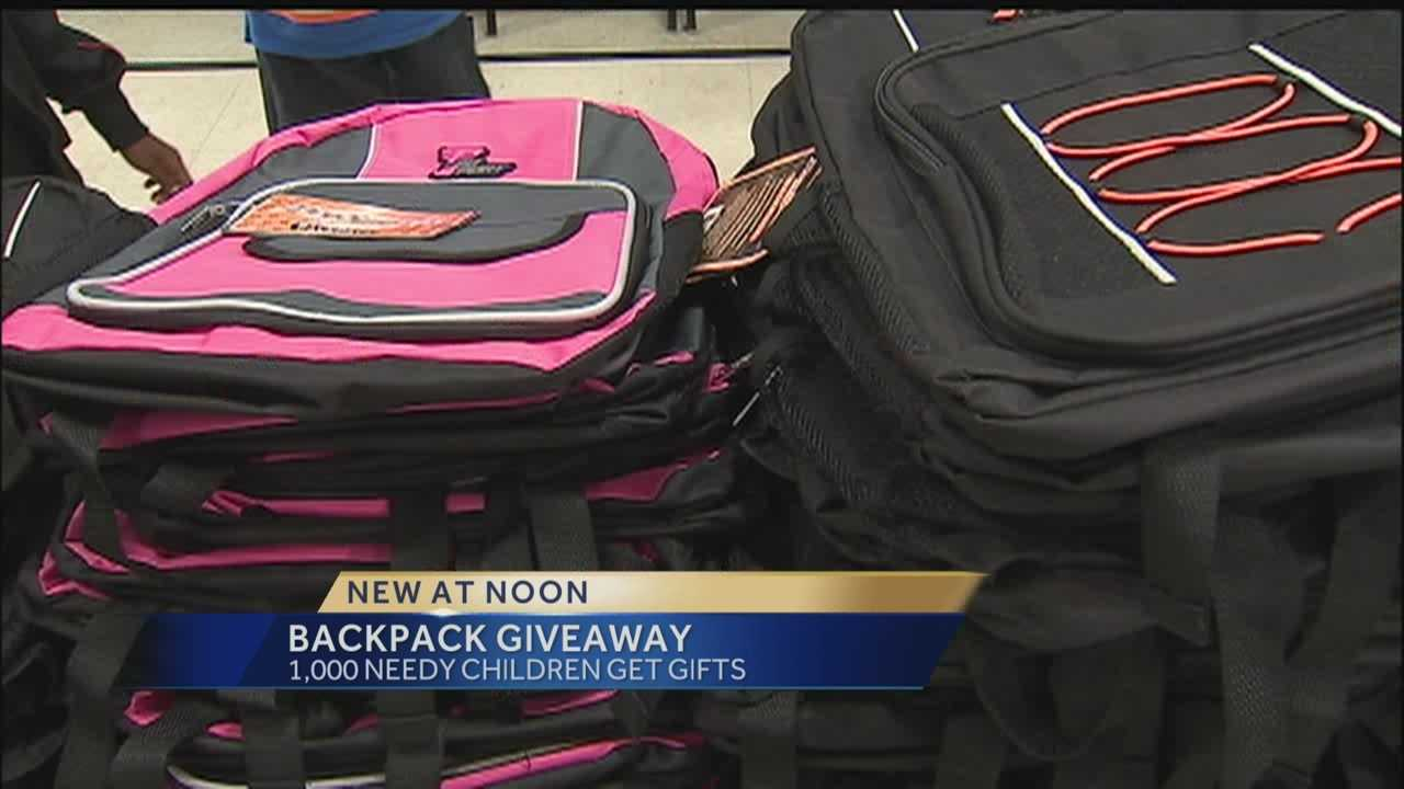 img-Backpacks filled with supplies given to area children