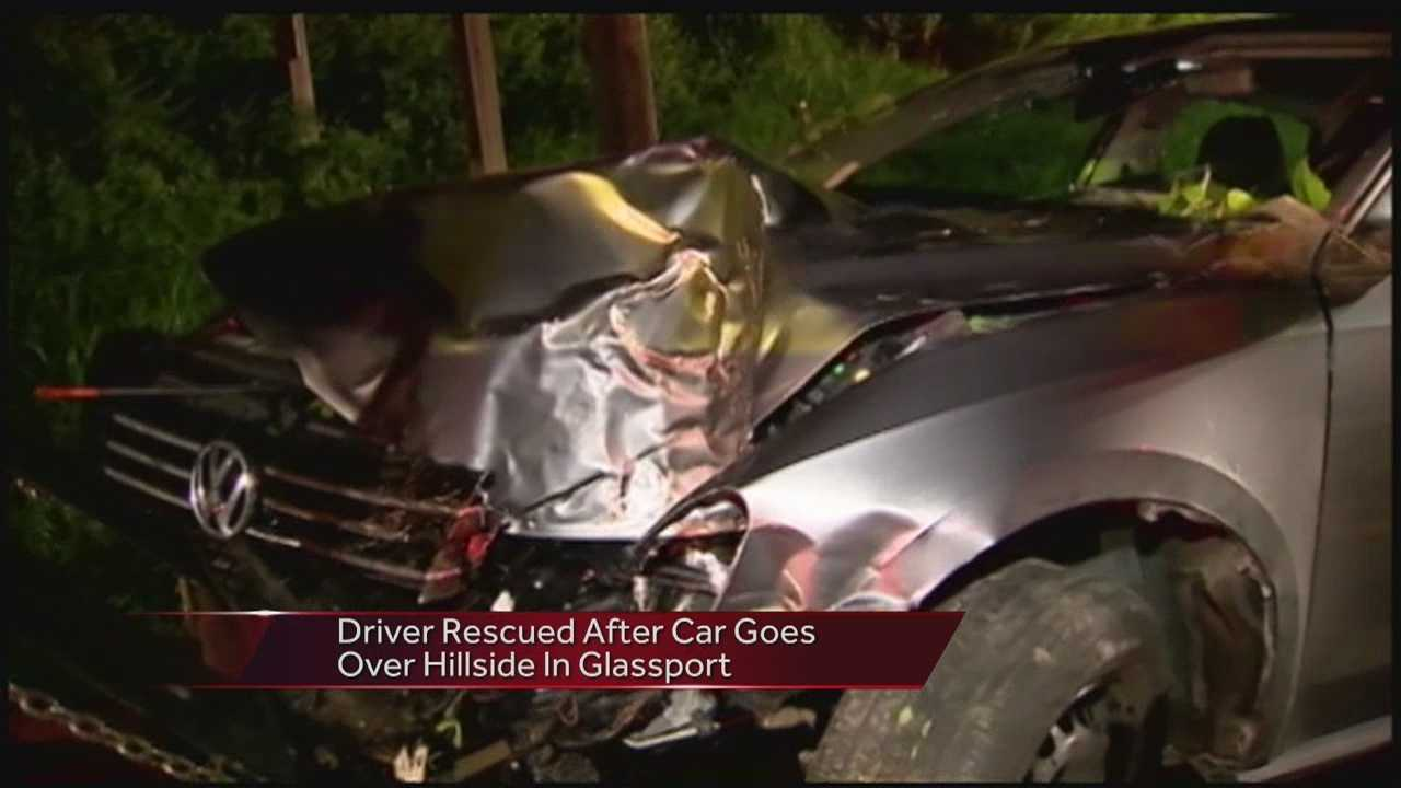 Man rescued after car drives over hill