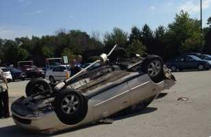 A car flipped onto its roof in a Giant Eagle parking lot in Monroeville.