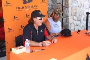 "WWE Hall of Fame wrestler Shawn Michaels (right) and his ""MacMillan River Adventures"" co-star Keith Mark signed autographs and took pictures with fans."