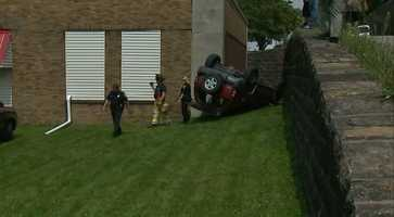 Police say speed was likely a factor Thursday afternoon when a driver flipped his SUV, landing upside down between a building and a wall.