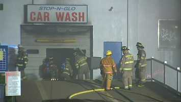 Flames tore through the Stop And Glo car wash along the 800 block of Fifth Avenue around 1:30 a.m. The building also houses a laundromat and auto body shop.