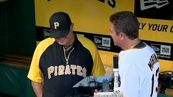 Pirates manager Clint Hurdle and Dan Marino in the team's dugout at PNC Park