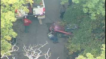A car crashed over a steep hillside in a wooded area of West Finley Township, Washington County.