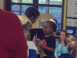 Hogan walked into the classroom and surprised her little girl, handing Jada a stuffed animal that she brought home from overseas.