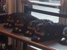 The Pirates wore these caps in the visiting locker room at Wrigley Field after Monday night's playoff-clinching victory in Chicago.