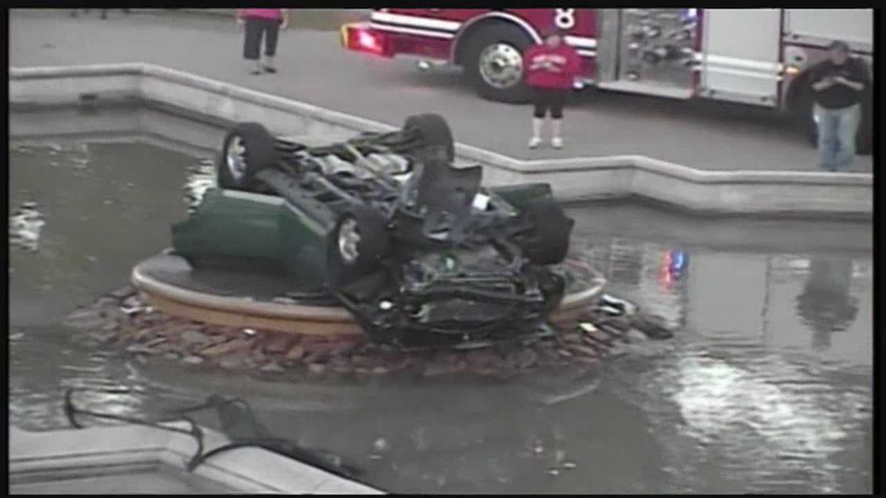 Car lands on roof in Highland Park fountain