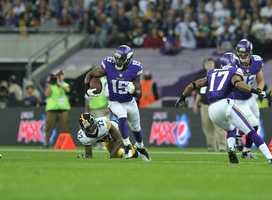 Vikings receiver Greg Jennings races toward the end zone.