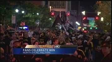 Pirates fans rushed out of PNC Park and into the North Shore streets, cheering and chanting after the playoff victory over the Cincinnati Reds. Their celebration continued well after the final out.