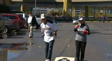 "A game of ""cornhole"" in the parking lot."