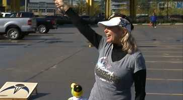 Carol Laratonda, of West Mifflin, waves a Jolly Roger flag in the parking lot outside PNC Park.
