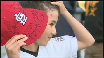 Jacob was holding out his St. Louis Cardinals cap, trying to get the attention of the Pittsburgh Pirates' opponents at PNC Park.