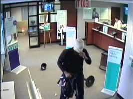 The robber remains at large. Police said he jumped over the counter and demanded that tellers open their drawers before he grabbed the money and hopped back over the desk.