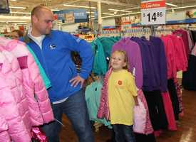 Meteorologist Ray Petelin strikes a pose with his little shopper