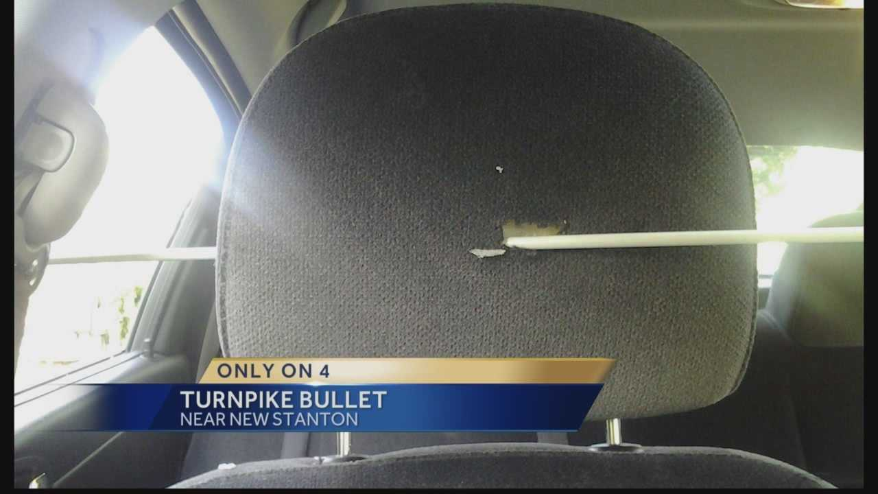 Couple almost hit by bullet while traveling on turnpike