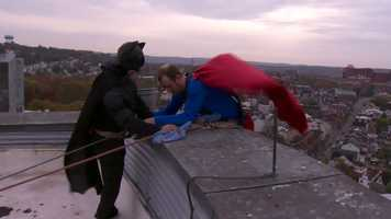 Batman gave his Justice League window-washing partner an assist over the ledge.