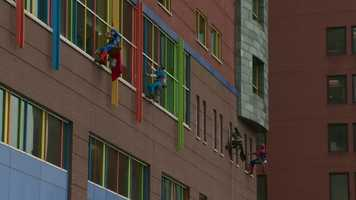 The superheroes from Allegheny Window Cleaning, Inc., did a job on the exterior of Children's Hospital of Pittsburgh while dressed in costumes on Halloween.